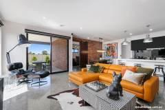 Virtue-Homes-Gallery2021-modern-pop-art-living-room-and-black-kitchen
