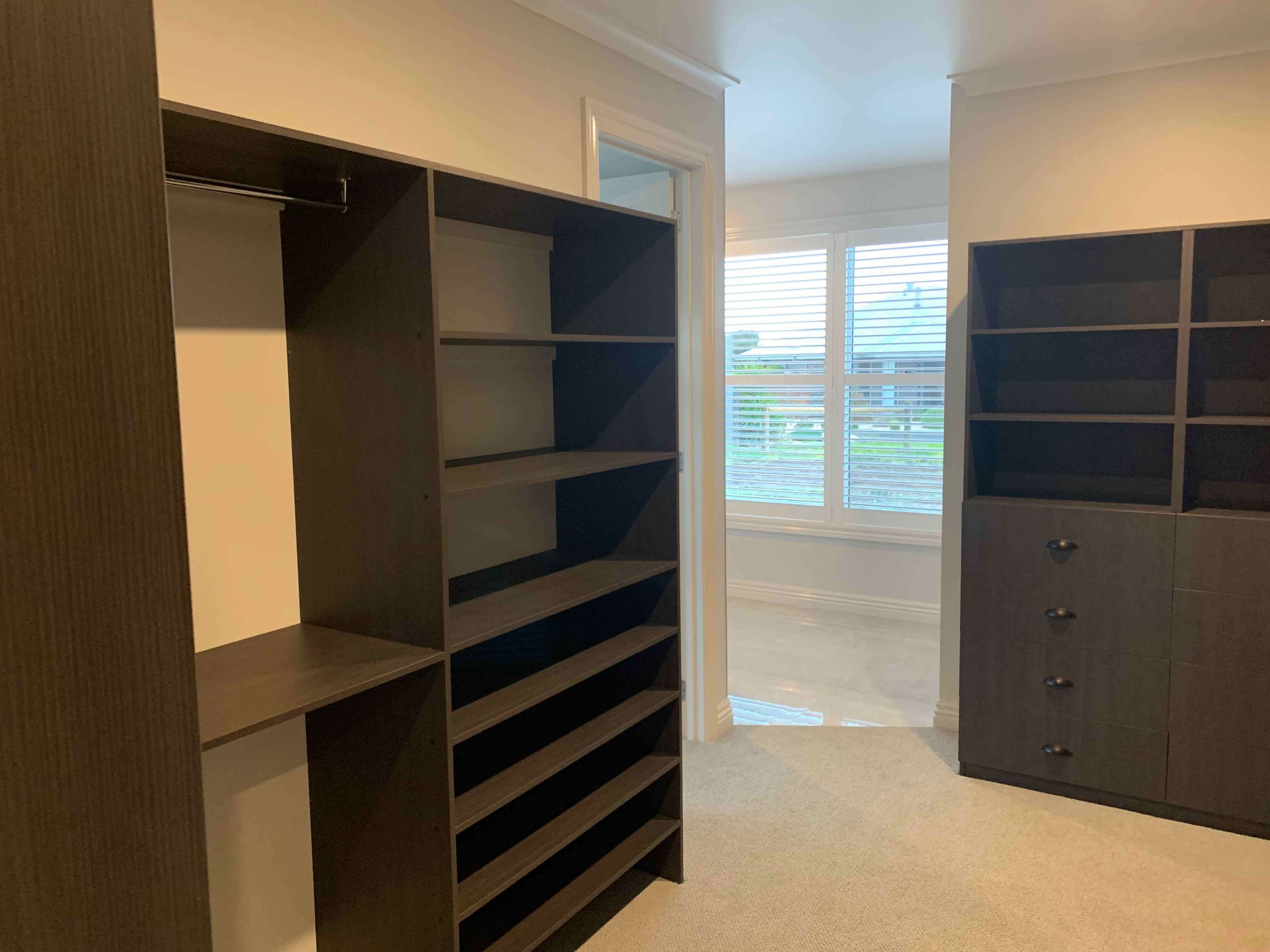 Walk in wardrobe in Ranch Style home by Virtue Homes