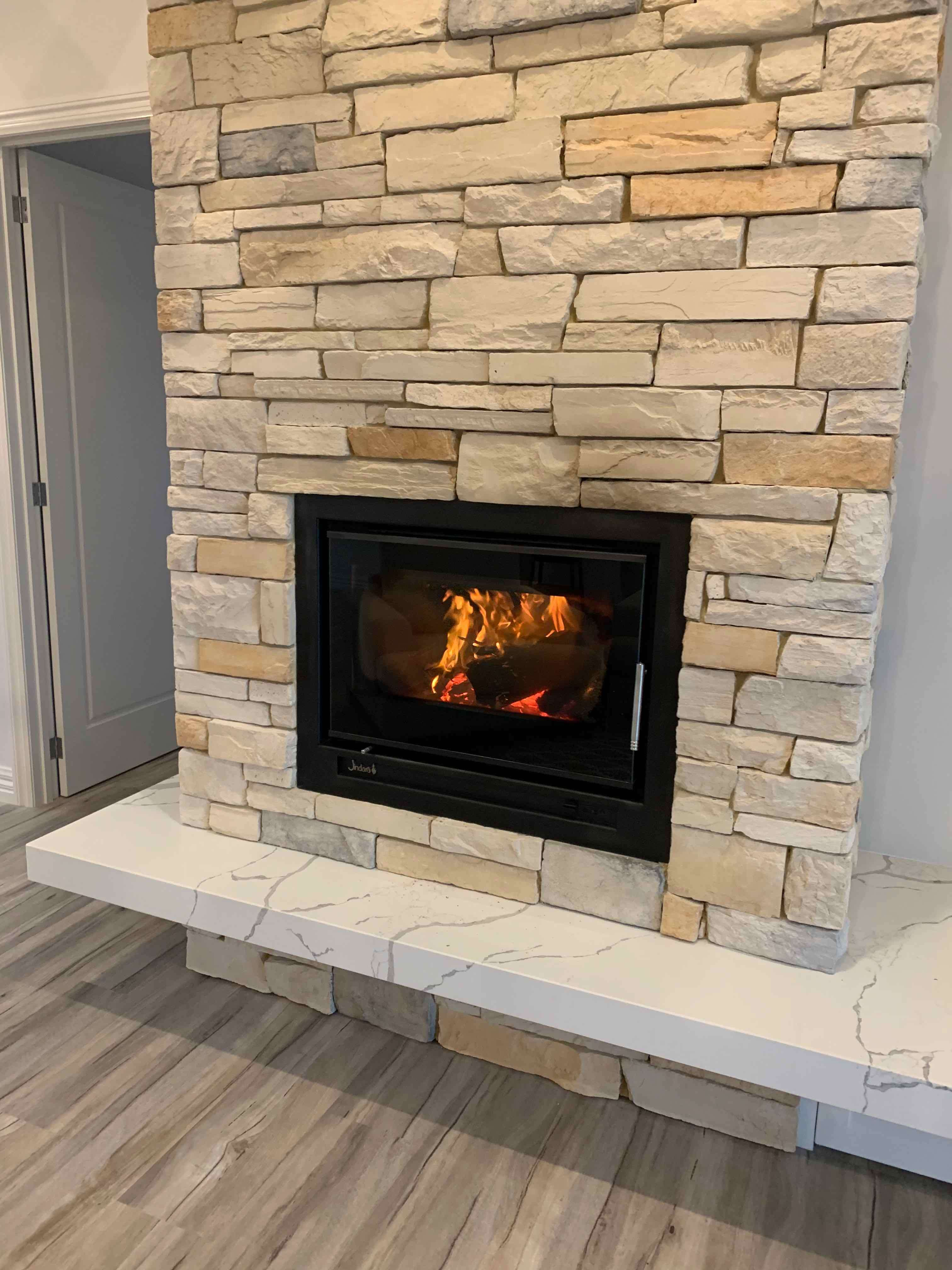 Stone fireplace in Ranch Style home by Virtue Homes