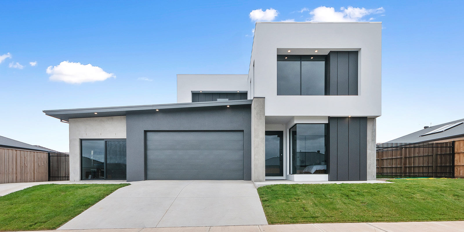 Modern white two storey home from the street