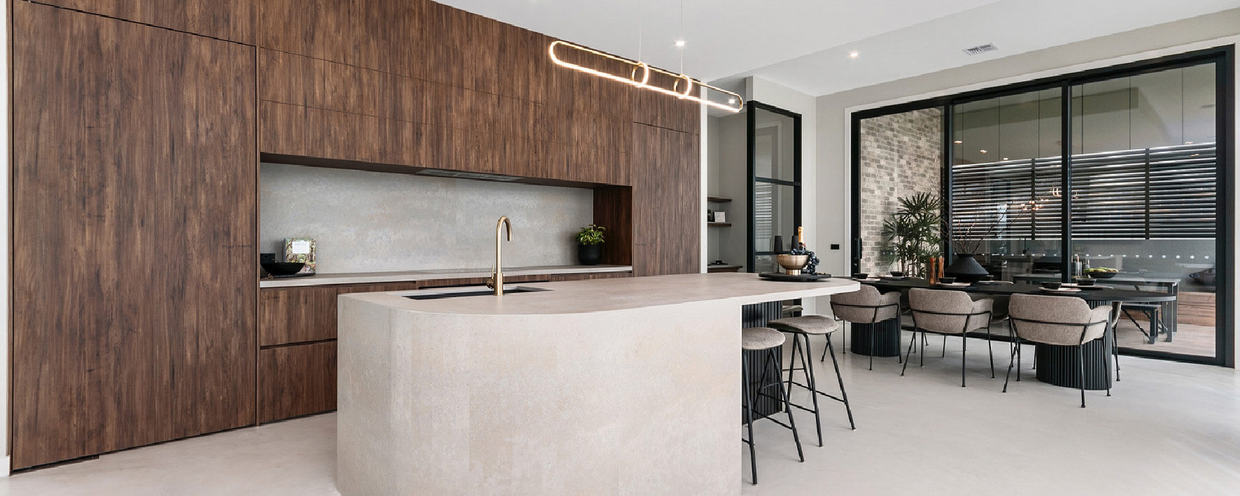 Timber and stone kitchen of Display Home by Virtue Homes