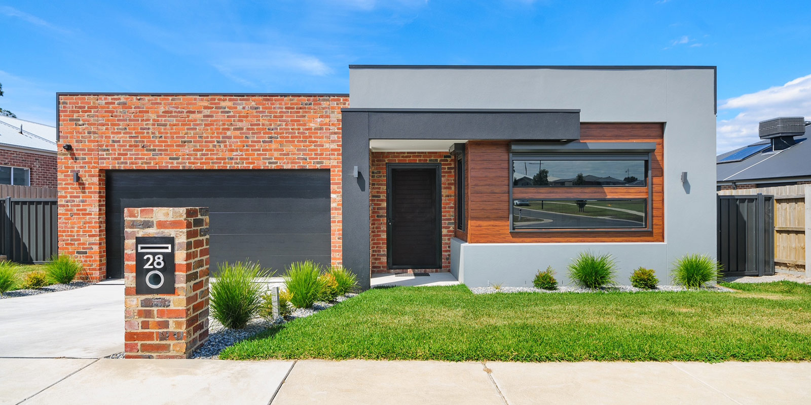 Custom Home by Virtue Homes with vintage red bricks and black contrast facade